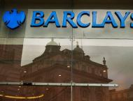 Barclays posts sliding first-half profits