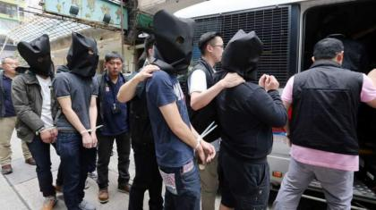 64 held with drugs,weapons