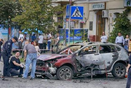 Journalist killed in Kiev car bombing buried in Belarus