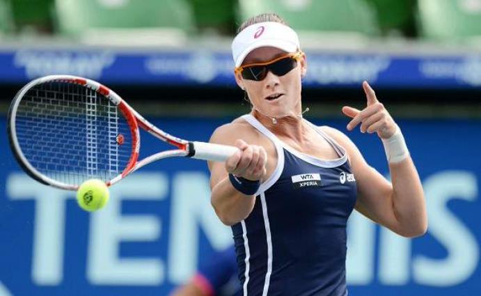 Tennis: Stosur advances after Wozniacki injures left arm