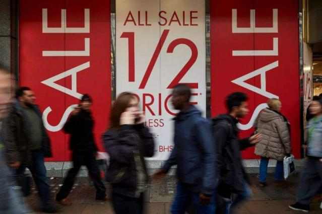 Britain's retail sales recoil on bad June weather