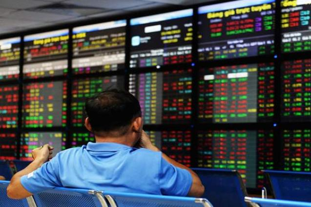 Hong Kong, Shanghai shares down by lunch