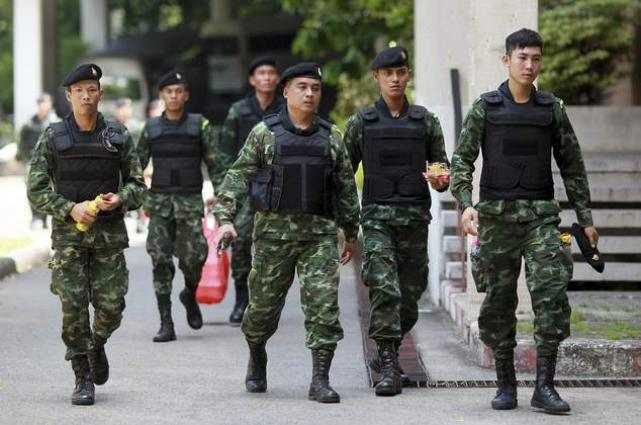 Thai cops charge 8-year-old girls under junta law