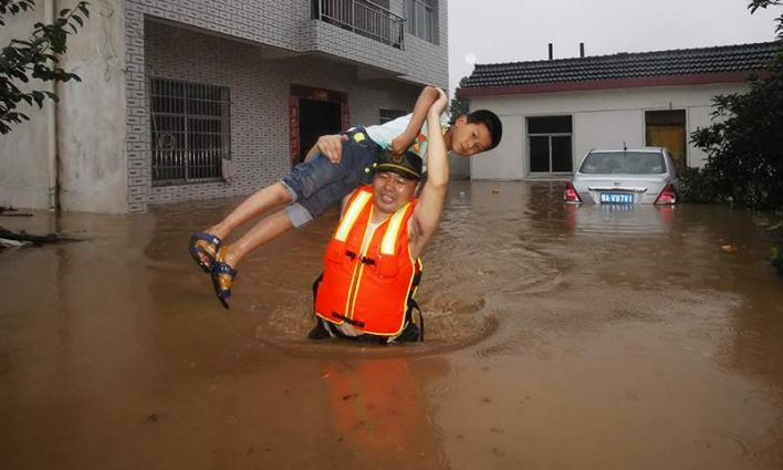 Nearly 300 dead or missing from China flooding: media