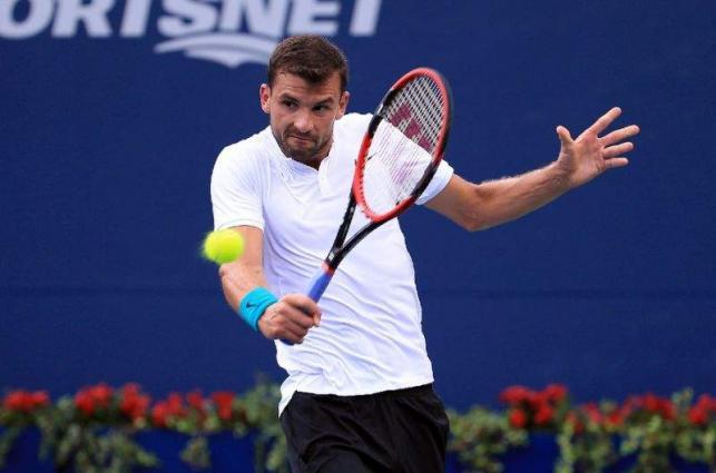 Tennis: Determined Dimitrov fights through in Canada