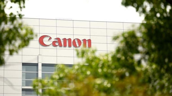 Canon slashes profit forecast on strong yen