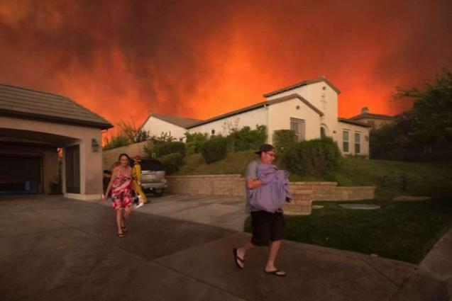 Raging wildfire engulfs California homes, film set