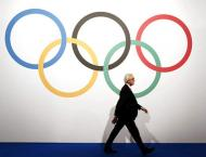 Olympics: IOC bans four after retests of Beijing-London dope samp ..