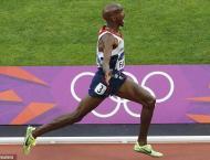 Olympics: 'Slow Moe' speeds to gold