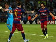 Football: Suarez gives Barcelona edge in Supercup