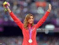 Olympics: Women's athletics 3000m steeplechase podium