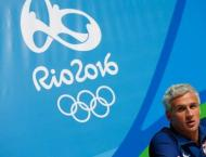 Olympics: Swim, IOC scandals overshadow Bolt's advance