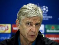 Football: Wenger adamant he's ready to spend