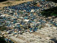 Migrant camp in Calais to be gradually dismantled: French ministe ..