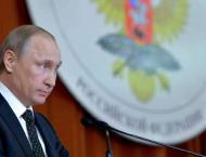 Putin says keen to solve Japan island row
