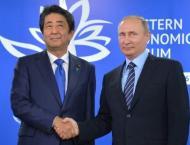 Putin, Abe seek progress on island row