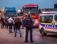 French farmers, truckers block roads in migrant camp demo