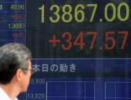 Tokyo stocks up by break as banks rally