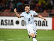 Football: Asano lays 'ghost goal' spectre to rest in Japan win