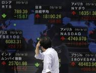 Tokyo shares open lower