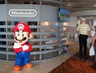 Tokyo shares dip by break, Nintendo soars on Apple