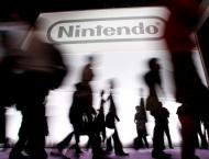 Tokyo stocks close lower but Nintendo soars on Apple tie-up
