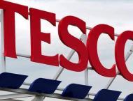 Britain charges three ex-Tesco execs over accounts
