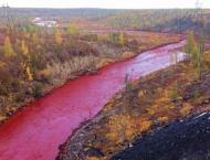 Russian metals giant admits red river leak