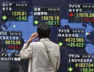 Japan stocks, dollar up on BoJ policy tweak
