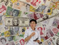 Dollar sinks, Asian stocks rally after Fed holds rates