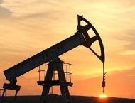 Oil rises on US stockpile drop, weaker dollar