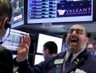 US stocks higher, joining global rally after Fed decision