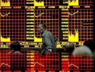 Tokyo stocks down by break on yen surge