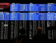 Tokyo stocks drop at open as yen surges