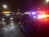 Four dead in Washington state mall, gunman on the run