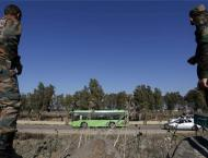 Rebels, families quit Syria's Homs under govt deal