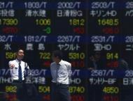Tokyo stocks gain after Clinton gets nod in debate