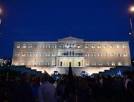 Greek lawmakers pass fresh reforms sought by creditors