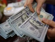 Dollar holds up as traders await Fed rate hike clues