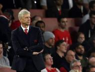 Football: Wenger says England job a possibility one day