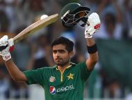 Cricket: Ton-up Azam lifts Pakistan as lights go out