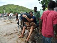 Chaos in Haiti after hurricane, but neighbors help out