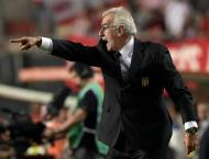 Football: Qatar coach plays down need for World Cup win