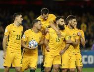 Football: Jedinak penalty earns draw for Australia against Japan