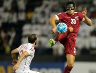 Football: Qatar edge Syria to keep World Cup dream alive