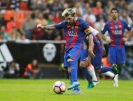 Football: Messi penalty snatches thrilling Barca win