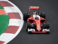 Vettel hands Ferrari boost, Hamilton edges Rosberg