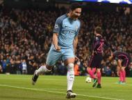 City stun Barca, Ozil magic as Arsenal progress