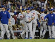 Baseball: Cubs find slugging form as elusive title one win away