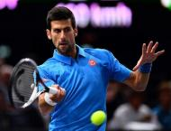 Tennis: Djokovic marches into Paris Masters third round